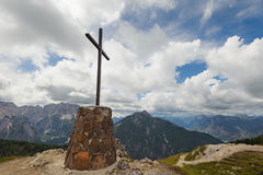 Mountain landscape with cross ,blue sky and clouds. Royalty Free Stock Photo