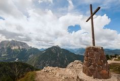 Mountain landscape with cross ,blue sky and clouds. Royalty Free Stock Photos