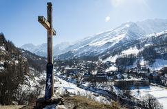 Mountain landscape. A Mountain landscape, with a cross and a snowboard Stock Photo