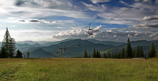 Mountain landscape. Ski chairlift line - Borsa, landmark attraction in Romania Stock Image
