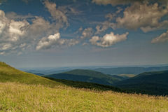 Mountain landscape with distant peaks. Poland,summer.Bieszczady mountins.Extensive, lightly blurred view on distant peaks Royalty Free Stock Image