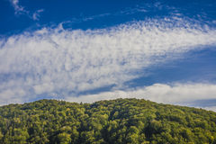 Mountain landscape in the early morning sky with clouds Stock Images