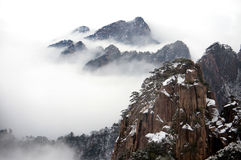 Mountain landscape with fog. Yellow moutain in winter with fog in China Royalty Free Stock Photography