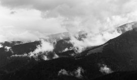 Mountain landscape with foggy clouds in a black and white interpretation, in Transalpina, Parang Romania Royalty Free Stock Image