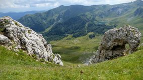 Mountain landscape with in foreground a rock to form of elephant in a natural park of Montenegro. Travel destination. Summertime and holidaytime. Field of stock image