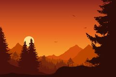 Mountain landscape with forest, under a orange sky with flying b. Irds and sun or moon Stock Photo
