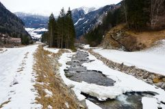 Mountain landscape, with frost river and forest in the bottom, Vipiteno, Italy Stock Image