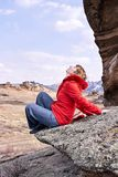 Mountain landscape. Girl tourist. Blue sky. Happy girl in stone Stock Photography