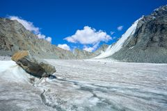 Mountain landscape with glacier and stone screes. Altai, Russia Stock Photos