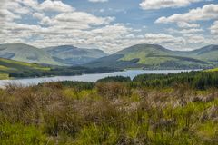Mountain landscape in the Glencoe area in Scotland, Springtime view mountains with grassland and countryside road in the valley of. The Scottish highland near Royalty Free Stock Photos