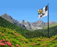Mountain landscape with Graubunden canton flag Stock Photo