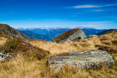 Mountain landscape. With green grass, rocks and blue sky stock photography