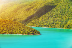 Mountain landscape in green wally. With crystal river stock photography