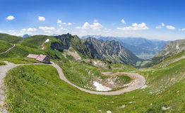 Mountain landscape with hiking trail and hut Royalty Free Stock Images