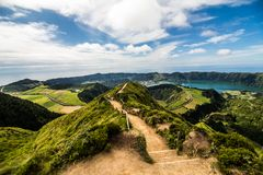 Mountain landscape with hiking trail and view of beautiful lakes Ponta Delgada, Sao Miguel Island, Azores, Portugal. Walking path to a view on the lakes of Sete stock photo