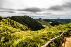 Mountain landscape with hiking trail and view of beautiful lakes Ponta Delgada, Sao Miguel Island, Azores, Portugal. royalty free stock photography