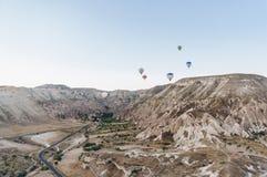 Mountain landscape with Hot air balloons,. Cappadocia, Turkey royalty free stock photography