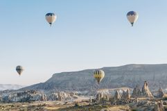Mountain landscape with Hot air balloons in Goreme national park, fairy chimneys,. Cappadocia, Turkey royalty free stock image