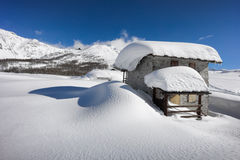 Mountain landscape, hut covered with snow in the mountains Royalty Free Stock Images