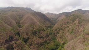 Mountain landscape indonesia. Aerial view slopes mountains covered with forest and vegetation. mountain hilly landscape in asia. tropical landscape stock video