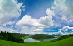 Mountain landscape with lake. Mountain landscape in green wally with crystal lake Royalty Free Stock Images