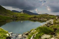 Mountain landscape. Lake Capra in Fagaras Mountain Royalty Free Stock Image