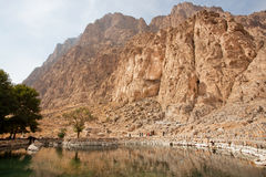 Mountain landscape with lake and trees in historical valley with rocky reliefs Stock Photos