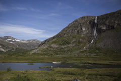 Mountain landscape with lake and waterfall, Norway Royalty Free Stock Images