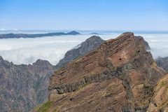Mountain landscape with low-slung clouds at Madeira seen from Pico do Arieira Royalty Free Stock Photos