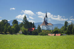 Mountain landscape, meadow and a church Royalty Free Stock Photo