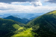 Mountain landscape with meadows, forest, hills and blue sky, Northern Slovakia. Mountain landscape with meadows, forest, hills and blue sky, Slovakia stock images