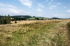Mountain landscape with meadows, forest, hills and blue sky - Svorad in Chocske vrchy mountains in Slovakia. Mountain landscape with meadows, forest, hills and royalty free stock image