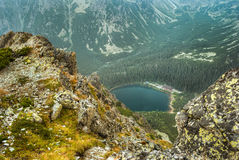 Mountain landscape with mountain chalet near the pond Stock Image