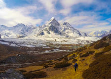 Mountain landscape of Nepal National Park. Nepalese people and severe nature. Icy and snowy peak of Kala Pattar. Himalaya trekking and mountaineering card or Stock Photo