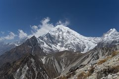 Mountain landscape in Nepal. Trekking in Himalaya mountains with snow peaks Stock Photo