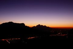 Mountain landscape at night. In Franschhoek, South Africa, shot from the highest point above the town royalty free stock photography
