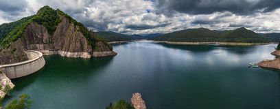 Mountain landscape panorama with dam and lake Stock Photos