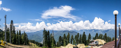Mountain landscape panorama. Mountain summer landscape panorama. Green forest and clouds Royalty Free Stock Images