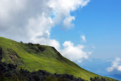 Mountain landscape panoramic with green meadow und Stock Photography