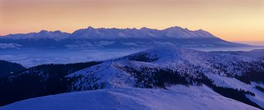 Mountain landscape panoramic view with blue sky Gorgeous winter sunset in mountains, Alps. Colorful outdoor scene, Christmas. Mountain landscape panoramic view royalty free stock image