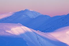 Mountain landscape panoramic view with blue sky Gorgeous winter sunset in mountains, Alps. Colorful outdoor scene, Christmas. Mountain landscape panoramic view stock photography