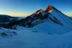 Mountain landscape panoramic view with blue sky Gorgeous winter sunset in mountains, Alps. Colorful outdoor scene, Christmas. Mountain landscape panoramic view royalty free stock photo