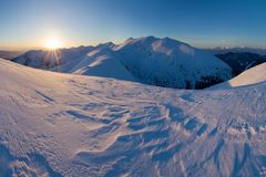 Mountain landscape panoramic view with blue sky Gorgeous winter sunset in mountains, Alps. Colorful outdoor scene, Christmas. Mountain landscape panoramic view stock images