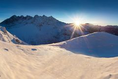 Mountain landscape panoramic view with blue sky Gorgeous winter sunset in mountains, Alps. Colorful outdoor scene, Christmas. Mountain landscape panoramic view stock image