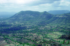 Mountain landscape with parallel fields near Panchgani, India Royalty Free Stock Photo