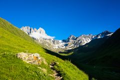 Mountain landscape of the peaks of Chauchi, Georgian Dolomites. Light and shade in the mountain valley. In the background are the summits of Chauchi Stock Image