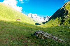 Mountain landscape of the peaks of Chauchi. Mountain camp in the valley Stock Photography
