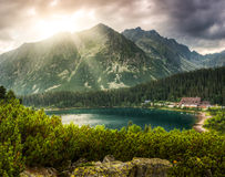 Mountain landscape with pond and mountain chalet Stock Image