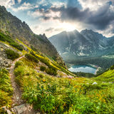 Mountain landscape with pond and mountain chalet Royalty Free Stock Image