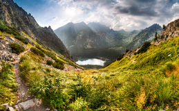 Mountain landscape with pond and mountain chalet Stock Photography